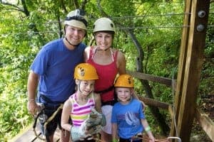Family ziplining, one of the most popular things to do while camping in the Great Smoky Mountains .