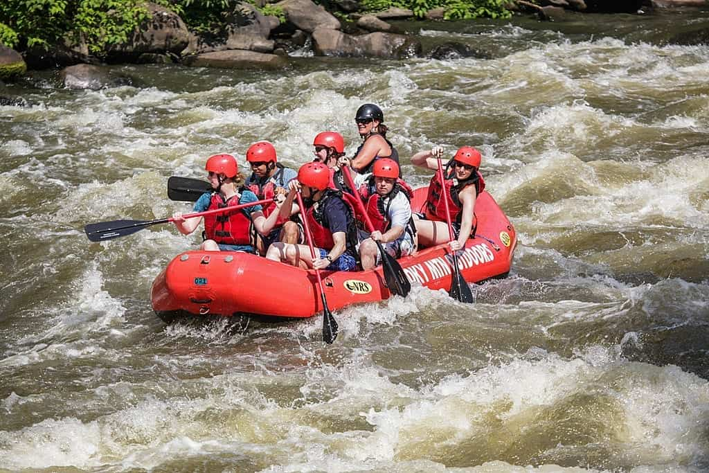 A group of people white water rafting near Gatlinburg at Smoky Mountain Outdoors.