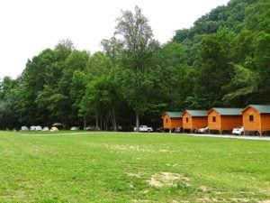 Cabins and tents at Pigeon River Campground in the Smoky Mountains.